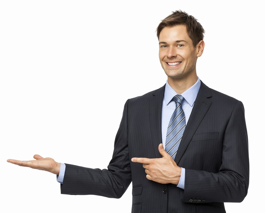 Smiling Businessman Pointing At Invisible Product